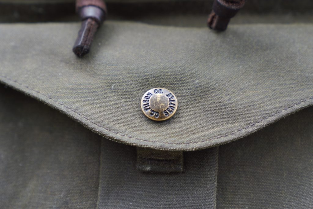 filson journeyman backpack button clasp