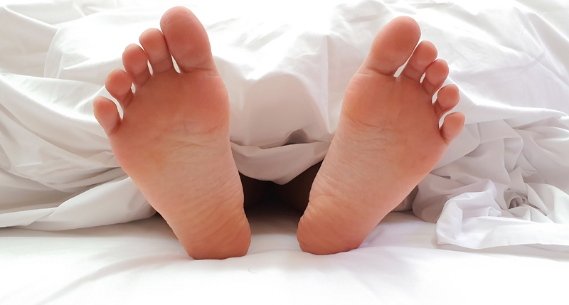 womens feet in bed
