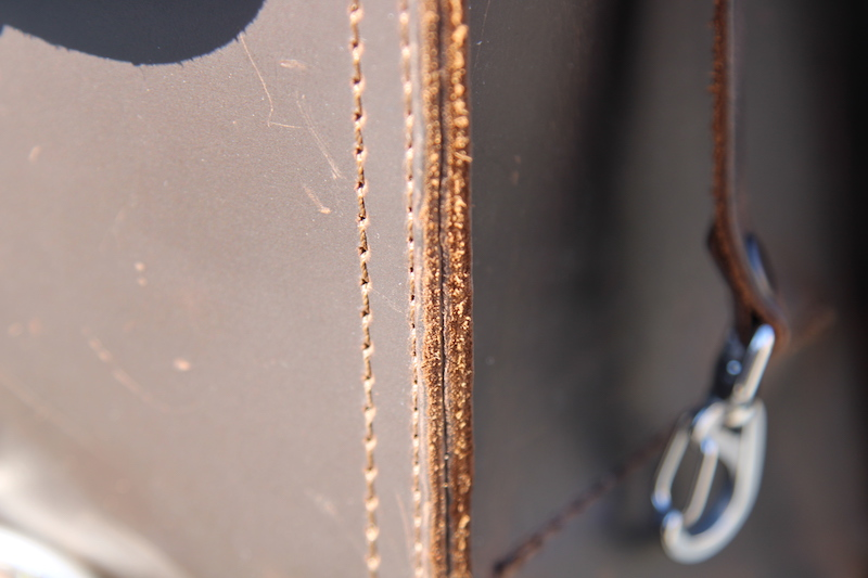 raw edges on saddleback bag