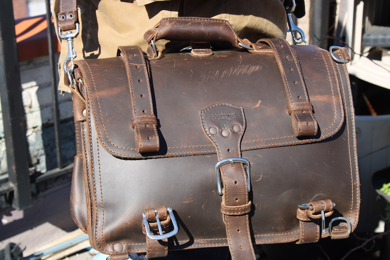 saddleback leather briefcase on person
