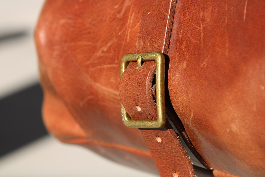 satchel and page mailbag buckle