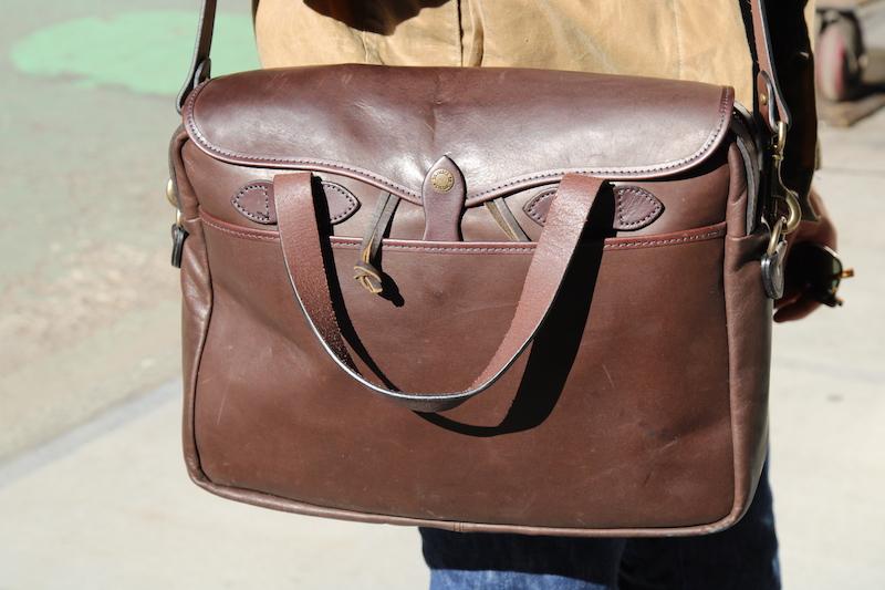 filson leather briefcase sunlight