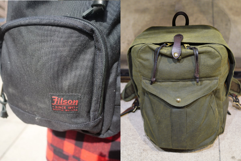 Filson Journeyman next to Dryden Logo