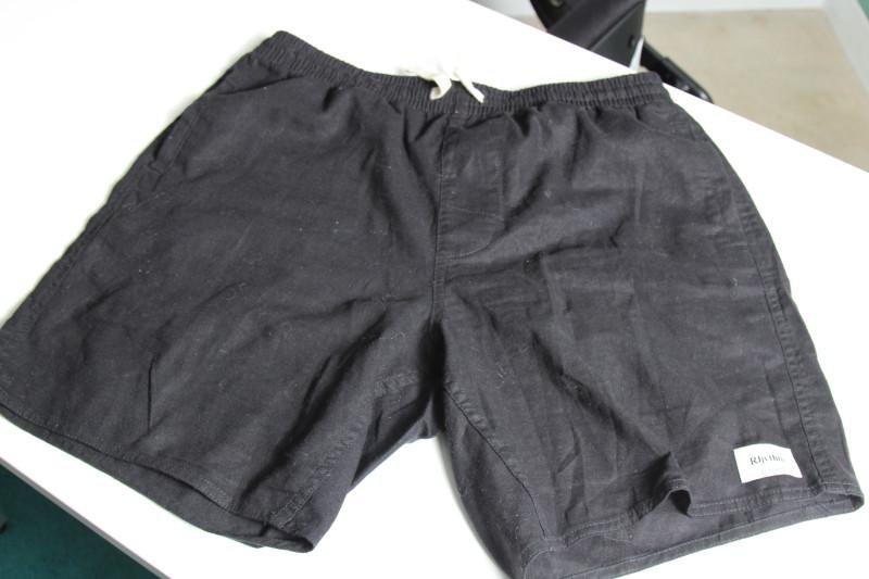 Rythm Classic Jam Black Shorts on a table
